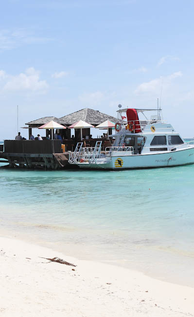 boat docked at pier at aruba