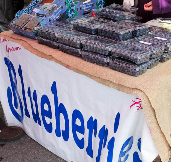 Blueberries in packages on table at farmers market