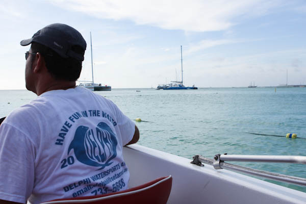 Boat captain looking out on the ocean