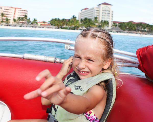 Skylar smiling on boat