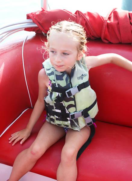 skylar wearing life jacket on red bench