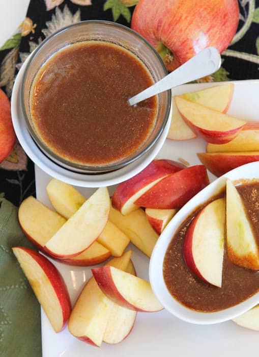 Dark Rum Caramel Sauce with apples around