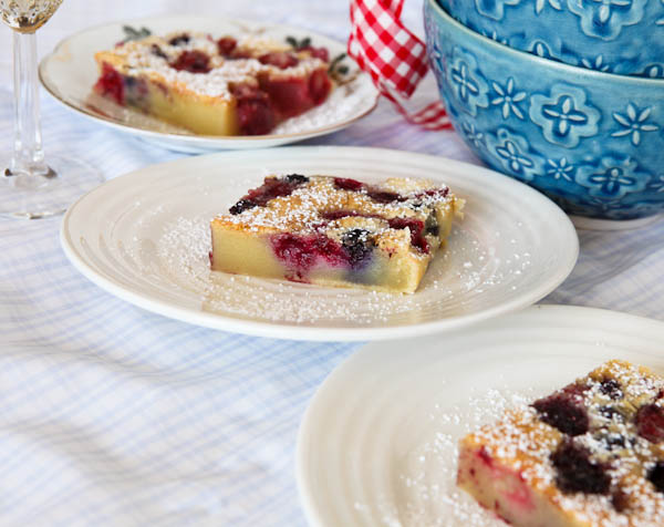 Mixed Berry Clafoutis on three white plates