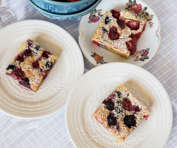 There plates of Mixed Berry Clafoutis slices