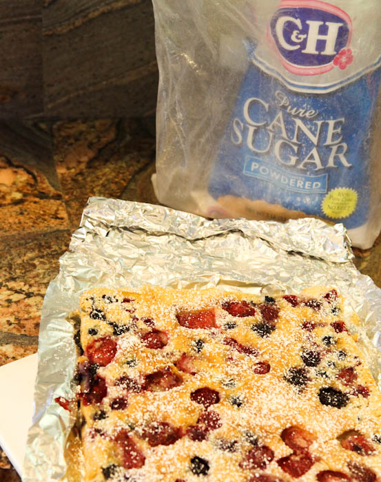 Unwrapped Mixed Berry Clafoutis sprinkled with powdered sugar