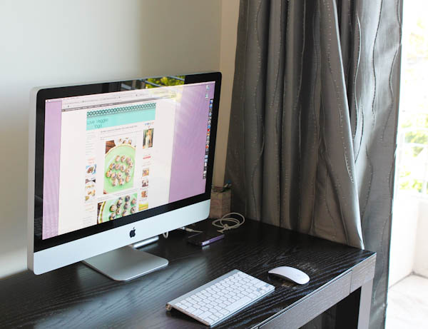 Desktop mac on black desk