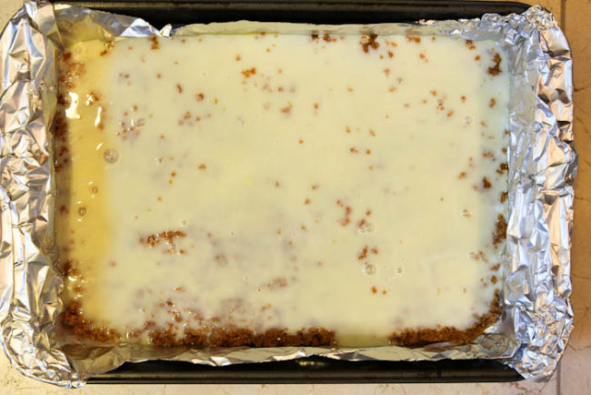 sweetened condensed milk poured over crumbs