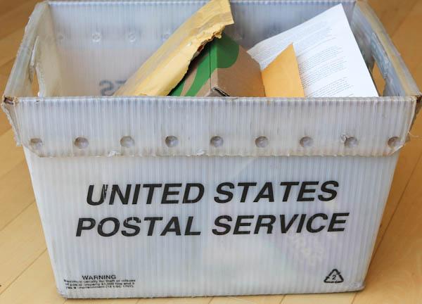 box of US postal service mail