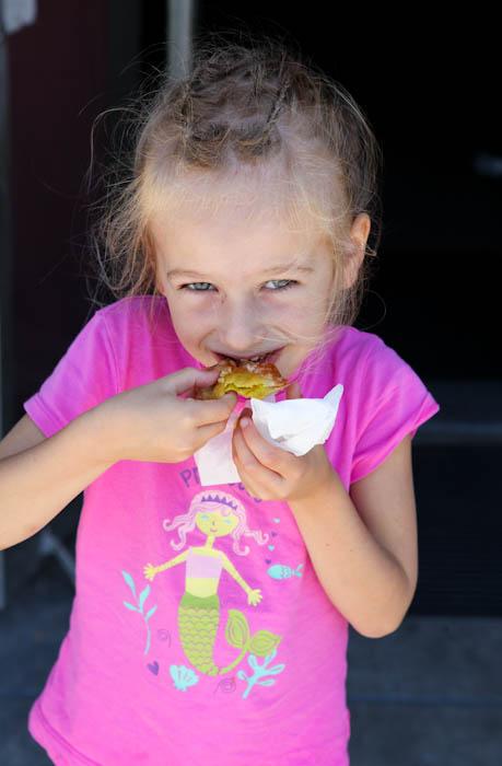 Young girl eating wonton