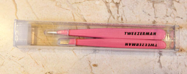 Two tweezers in a container