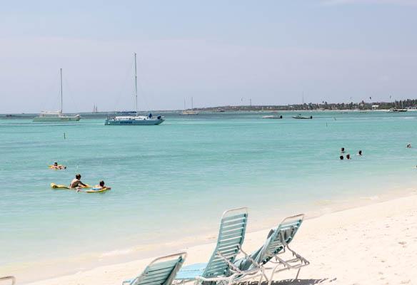 Aruba beach with beach chairs and blue ocean