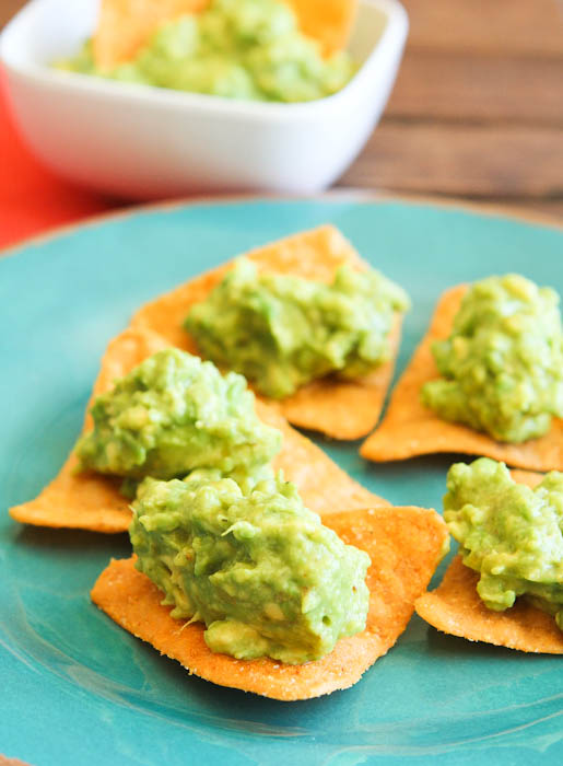 Guacamole on chips on teal plate
