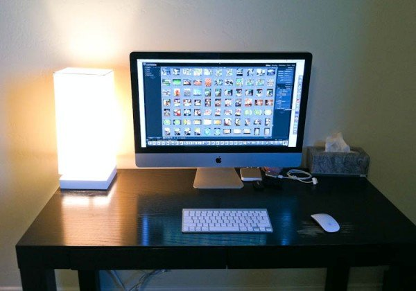 Computer set-up on desk with lamp