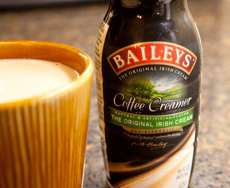 Baileys Coffee Creamer next to Mug of coffee