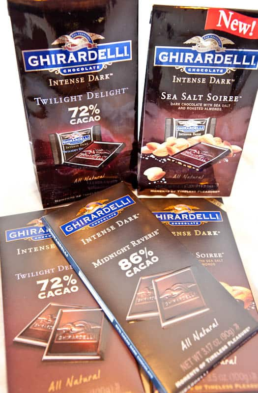 Multiple bars and packages of Ghirardelli Dark Chocolates
