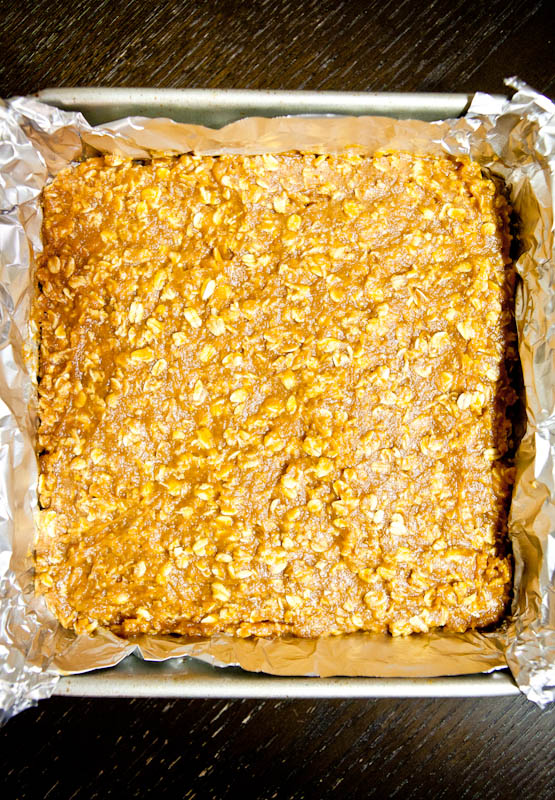 Pumpkin Peanut Butter Oatmeal Bars in foil lined baking pan