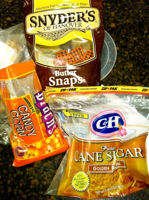 Ingredients on counter -- brown sugar, candy corn, and butter snap pretzels