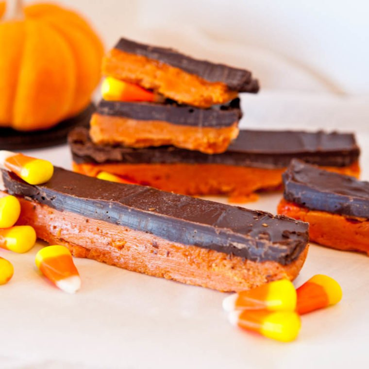 Butterfinger Bars with candy corn scattered and chocolate top layer