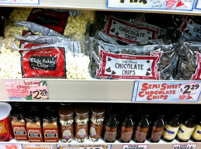Trader Joe's bags of white baking chips and chocolate chips on shelves