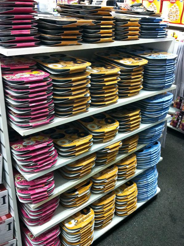 Store shelves of baking pans