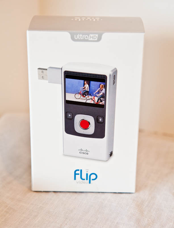 Flip Ultra HD Camera with usb coming out of it