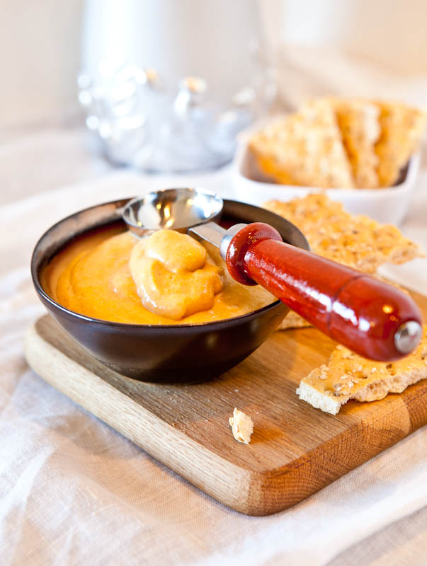 Caramel Pumpkin Whip Dip with red handle scoop in brown bowl and crackers
