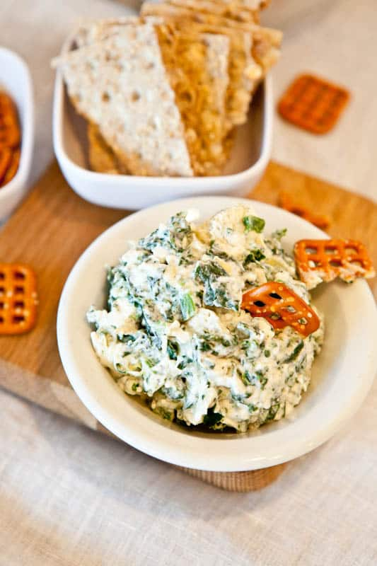 Spinach and Artichoke Dip with pretzels and crackers