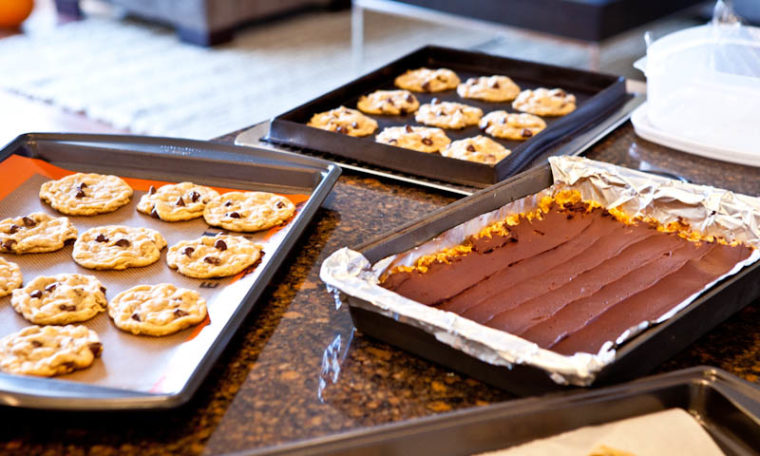Cookies on baking sheets and bars in pan
