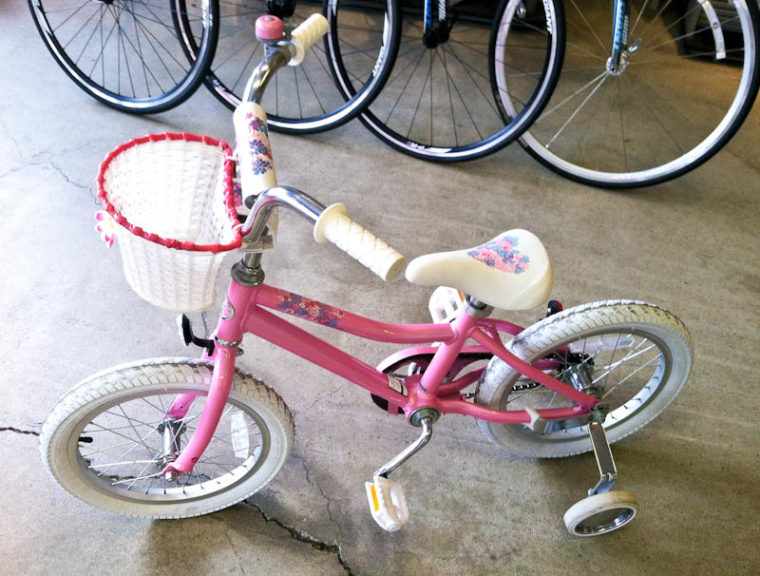 Pink Bicycle with training wheels and basket