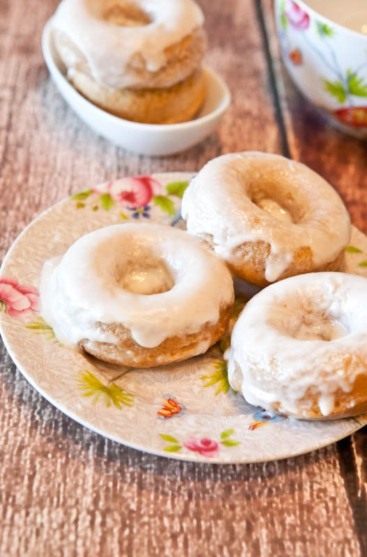 Baked Cinnamon Bun Donuts with Vanilla Cream Cheese Glaze  on pattered plate