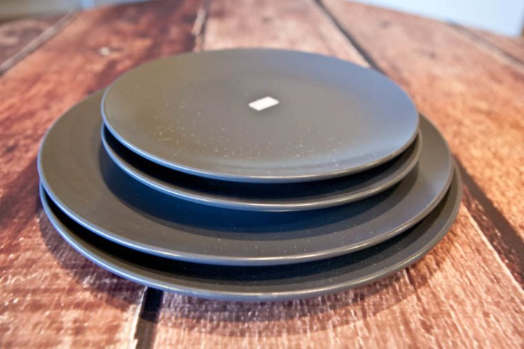 Four black plates stacked