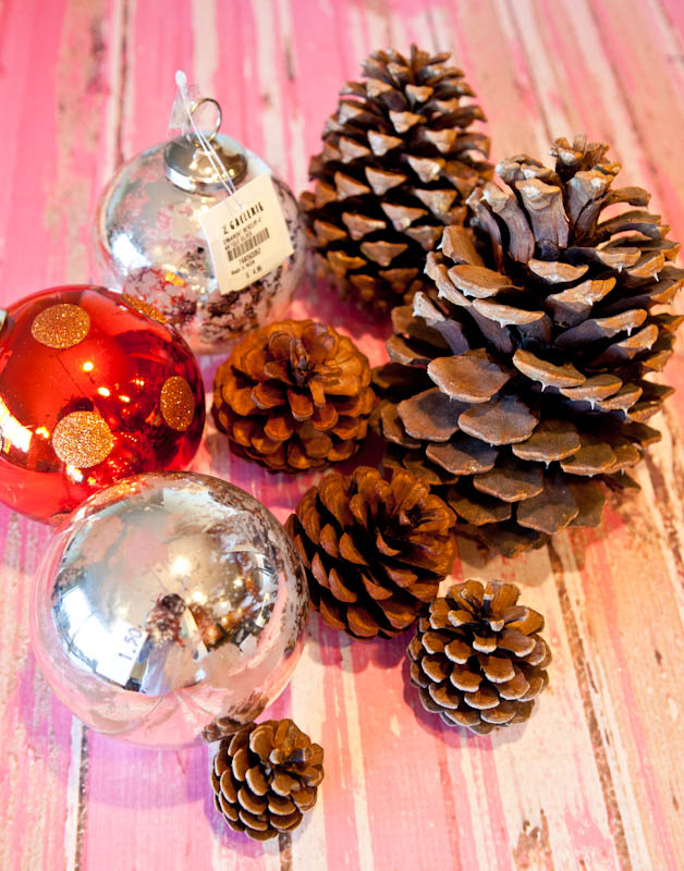 silver and red ornaments and pinecones