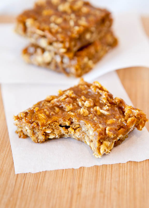Pumpkin Peanut Butter Oatmeal Bars stacked on paper