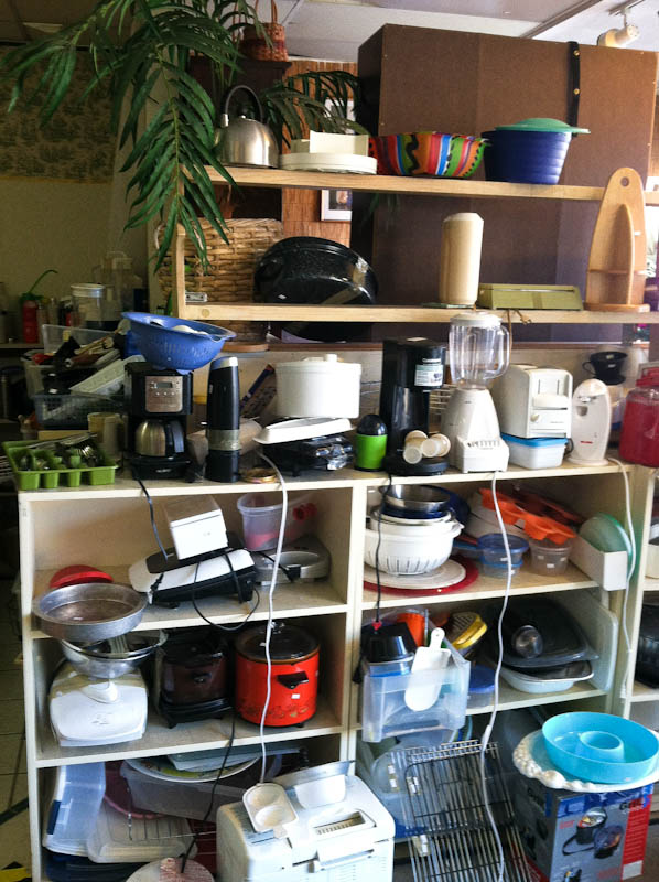 Thrift store shelves with kitchen supplies such as blenders