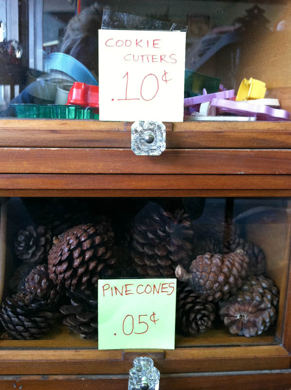 cookie cutters 10 cents, pinecones 5 cents, each on different shelves