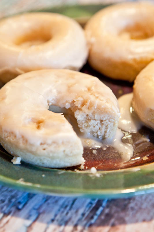 Baked Vanilla Donuts with Vanilla Glaze on green and red plate cut up