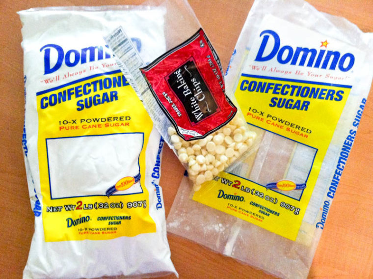 Bags of confectioners sugar and white chocolate chips