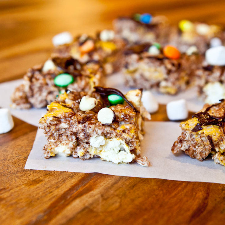 Double Chocolate Caramel Corn & Cocoa Rice Krispies Candy Bars on paper
