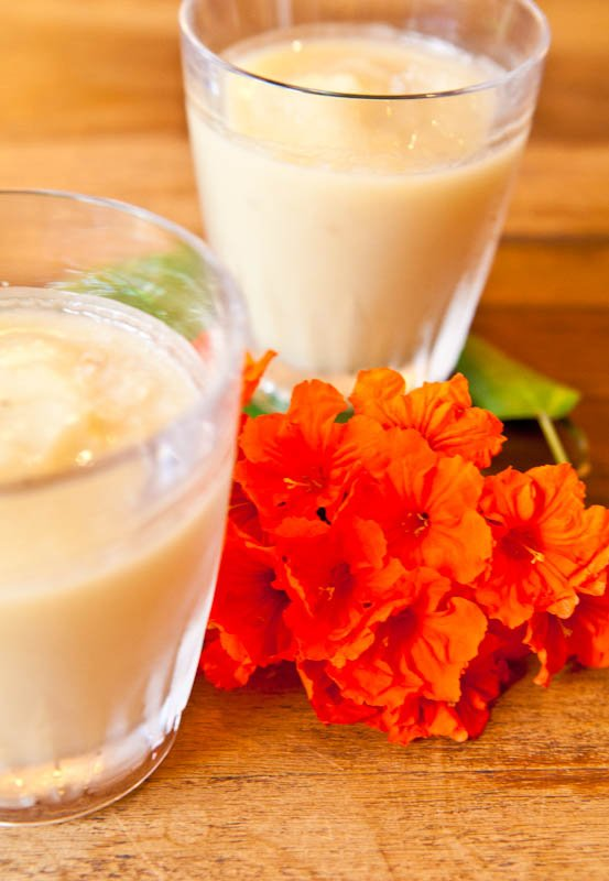 Pineapple Banana & Coconut Cream Smoothies with orange flowers