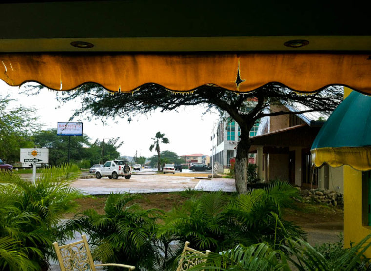 Rain in Aruba from underneath awning