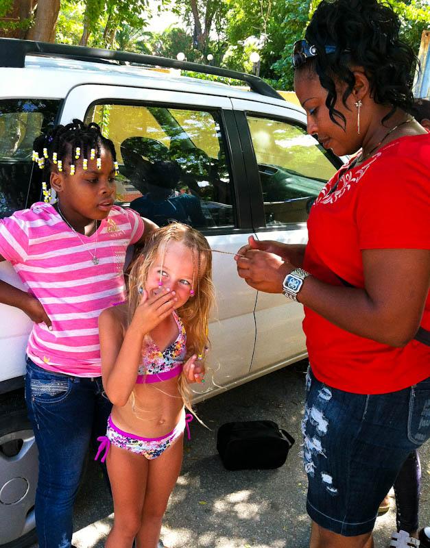 Skylar getting braids in her hair