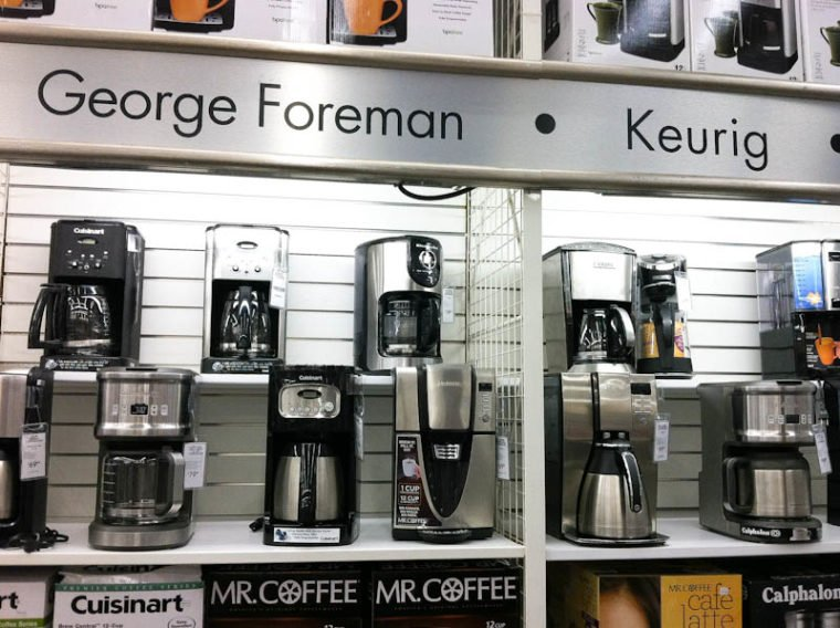 bed bath and beyond store wall of coffee makers