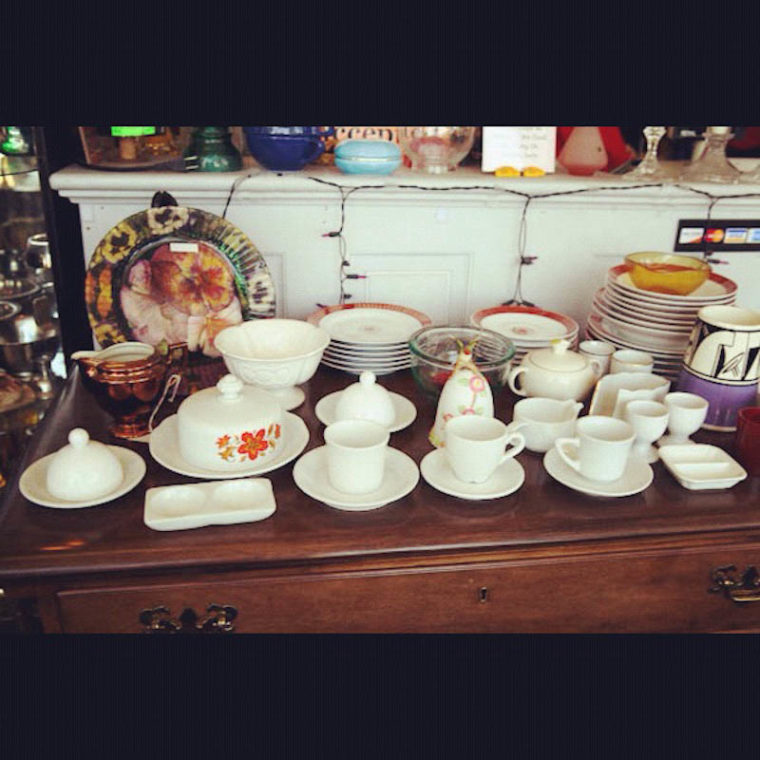 Thrift store shelf of teacups