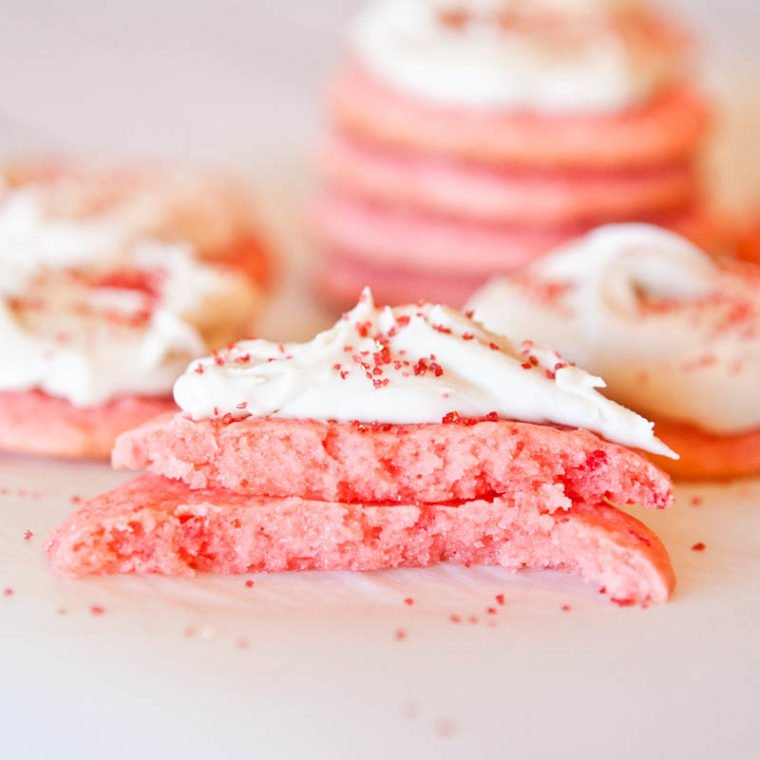 Strawberry Cake Mix Cookie with Vanilla Cream Cheese Frosting in half