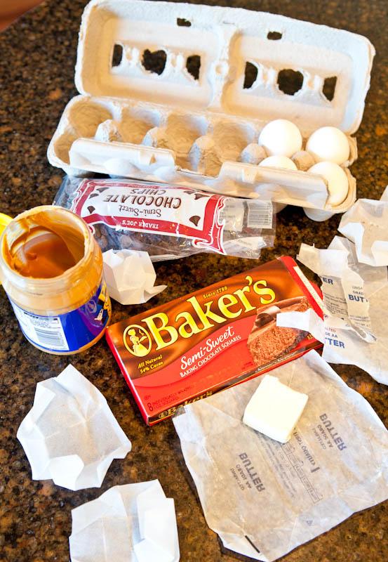 Baking supplies: eggs, chocolate, peanut butter, and butter