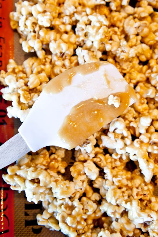 Vanilla Cake Batter and White Chocolate Chip Caramel Corn with spatula with caramel on it