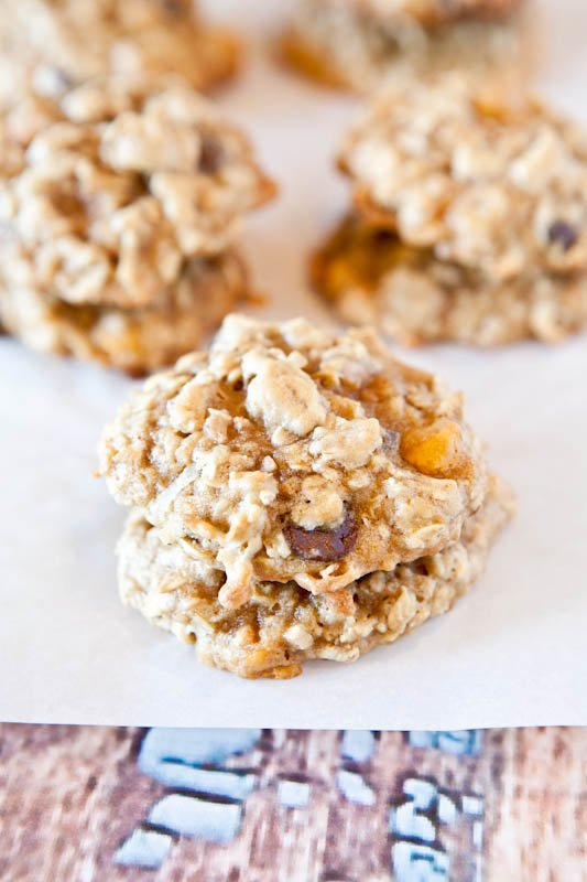 Soft and Chewy Coconut Oatmeal Toffee Cookies - There's toffee, chocolate chips, and butterscotch chips in these easy cookies full of texture and rich coconut flavor!