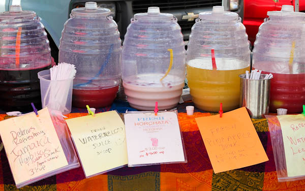 jugs filled with drinks at farmers market