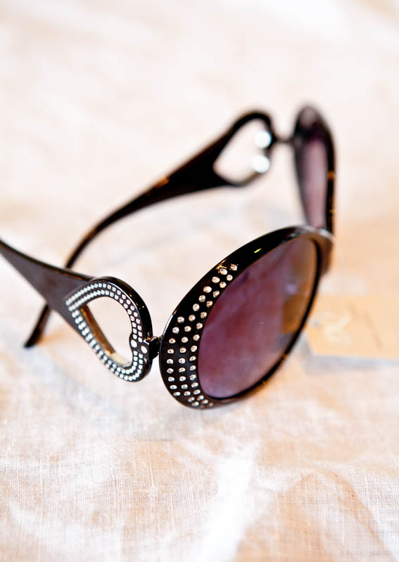 Sunglasses with rhinestones on frames and heart shaped ears