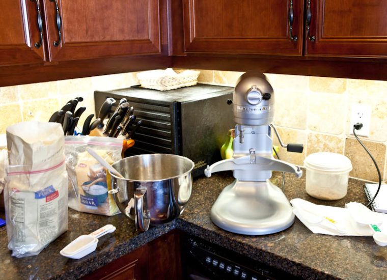 Kitchen counter with dirty dishes and kitchen aid mixer
